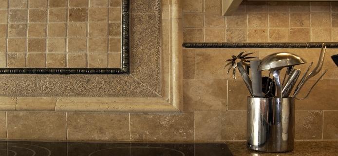 Tumbled travertine subway tile backsplash